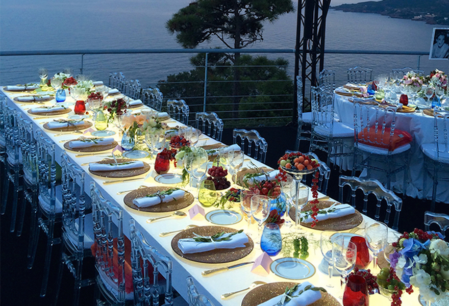 Table laid out for an outdoor dinner party at the Palais Bulles