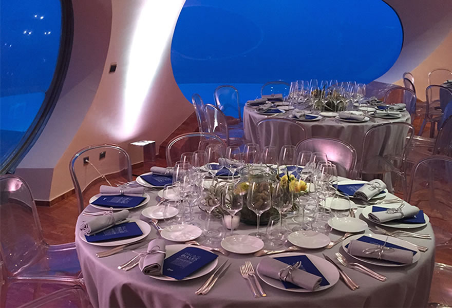 Table laid out for an indoor dinner party at the Palais Bulles